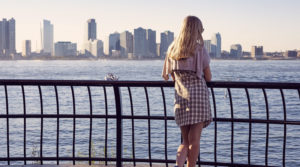 girl looking at new york city